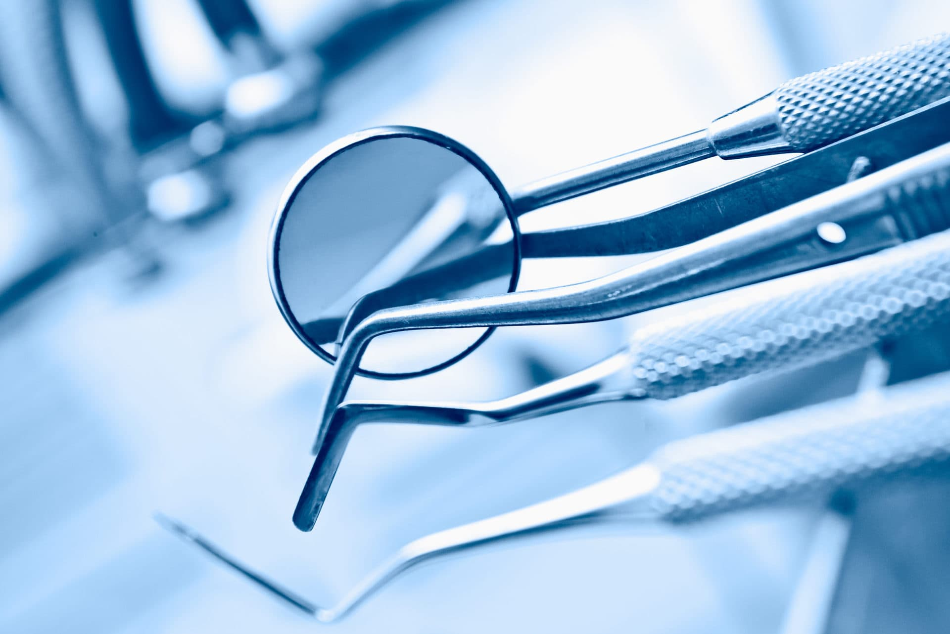 dentist's instruments with shallow depth of field blue tinted